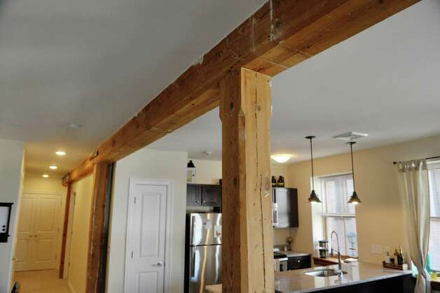 A view of the original wooden beams exposed inside a two bedroom, one bath, second floor apartment in the Argus Building at 412 Broadway on Thursday, March 12, 2015, in Albany, N.Y.   (Paul Buckowski / Times Union) Photo: PAUL BUCKOWSKI / 00030983A