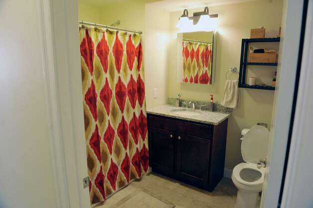 A view of bathroom inside a two bedroom, one bath, second floor apartment in the Argus Building at 412 Broadway on Thursday, March 12, 2015, in Albany, N.Y.  This apartment unit is ADA compliant.  (Paul Buckowski / Times Union) Photo: PAUL BUCKOWSKI / 00030983A