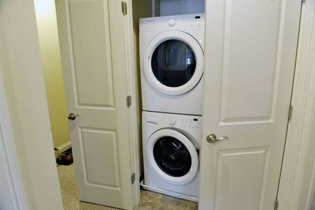 A view of the in-unit washers and dryers inside a two bedroom, one bath, second floor apartment in the Argus Building at 412 Broadway on Thursday, March 12, 2015, in Albany, N.Y.   (Paul Buckowski / Times Union) Photo: PAUL BUCKOWSKI / 00030983A