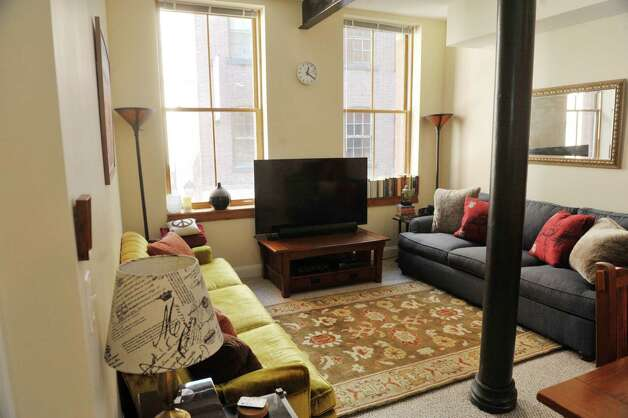 A view of living room inside a one bedroom apartment in the Argus Building at 412 Broadway on Thursday, March 12, 2015, in Albany, N.Y.   (Paul Buckowski / Times Union) Photo: PAUL BUCKOWSKI / 00030983A