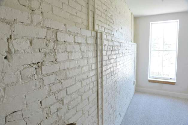 A view of the exposed brick inside an apartment in the Argus Building at 412 Broadway on Thursday, March 12, 2015, in Albany, N.Y.   (Paul Buckowski / Times Union) Photo: PAUL BUCKOWSKI / 00030983A