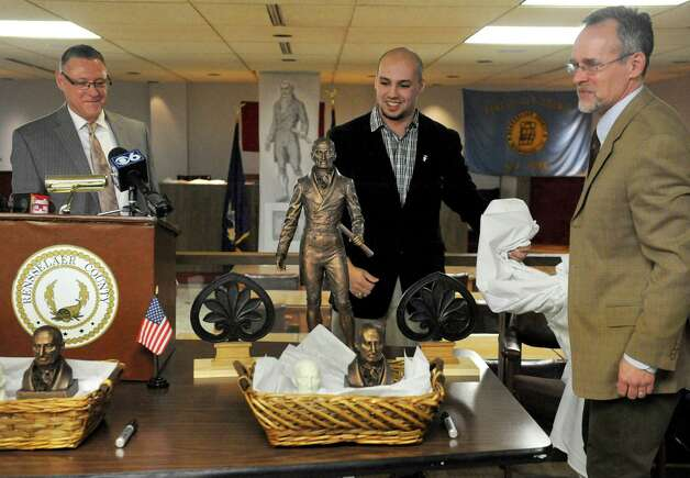 Legislator Gary L. Pavlic, left, Adam Sanzone, center, and sculptor Patrick Pigott unveil a model of the Col. Albert Pawling Memorial Statue during a fundraising campaign kickoff at the Rensselaer County Office Building on Thursday March 19, 2015 in Troy, N.Y.  (Michael P. Farrell/Times Union) Photo: Michael P. Farrell / 00031050A