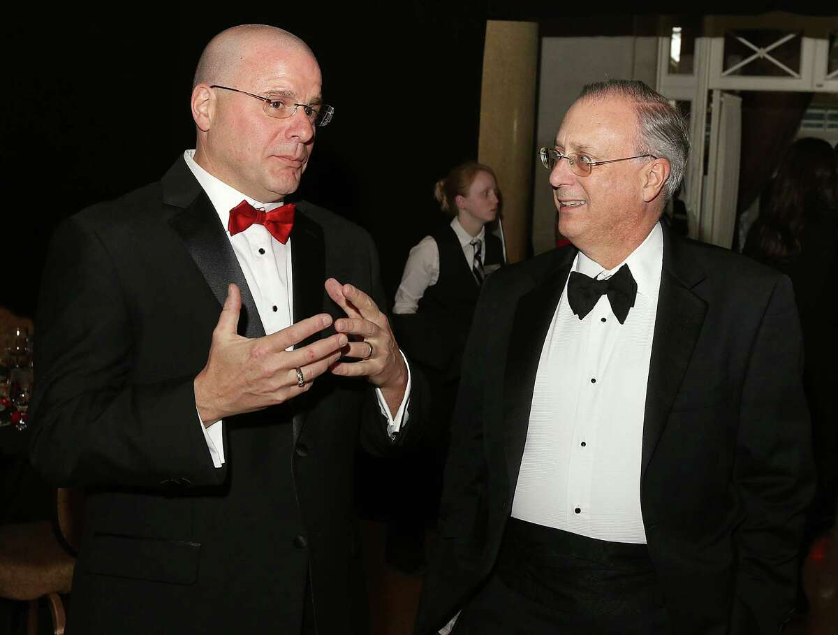 Saratoga Springs, NY - March 14, 2015 - (Photo by Joe Putrock/Special to the Times Union) - American Heart Association Executive Director John Guastella(left) talks with CDPHP President and CEO John Bennett, MD(right), who will be the 2016 Heart Ball Chair, during
