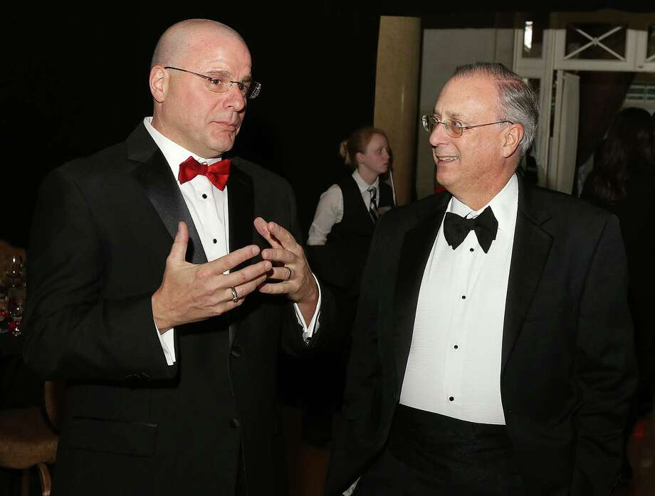 "Saratoga Springs, NY - March 14, 2015 - (Photo by Joe Putrock/Special to the Times Union) - American Heart Association Executive Director John Guastella(left) talks with CDPHP President and CEO John Bennett, MD(right), who will be the 2016 Heart Ball Chair, during ""Radio Days"", the 32nd Annual Capital Region Heart Ball to benefit the American Heart Association at the Hall of Springs in Saratoga Springs, NY. ORG XMIT: 08 Photo: Joe Putrock / Joe Putrock"