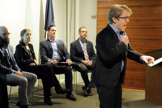"Baritone Daniel Belcher, right, performs a song from the opera ""The Long Walk"" on Thursday, March 12, 2015, at the New York State Military Museum in Saratoga Springs, N.Y. Joining him from left, are Opera Saratoga's Jeremy Howard Beck, Stephanie Fleischmann and Lawrence Edelson and author Brian Castner. A reading, discussion and performance introduced an opera based on Castner's Iraq War memoir that's being developed by Opera Saratoga. (Cindy Schultz / Times Union) Photo: Cindy Schultz / 00030993A"