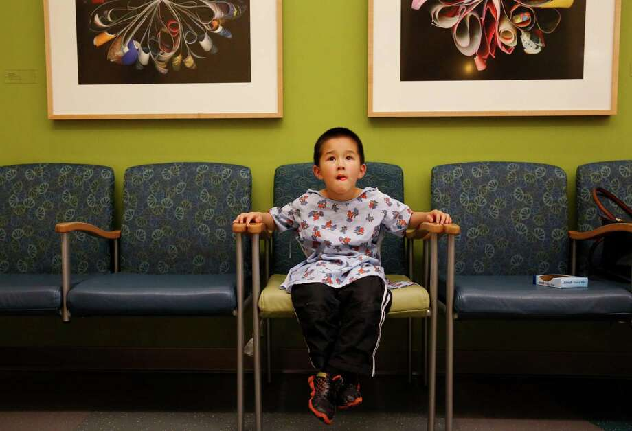 Alex, 5, (whose mother preferred to withhold his last name) watches a movie as his back itches while he waits for the allergens applied to it to set in during a skin test in the Kaiser Permanente Allergy Department March 18, 2015 in Sunnyvale, Calif. Photo: Leah Millis / The Chronicle / ONLINE_YES