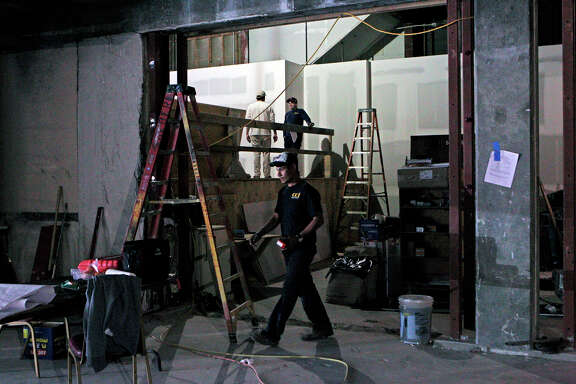 A worker builds the first floor at China Live, which will feature high-end restaurants, bars and retail space. Developers are taking advantage of the site in Chinatown abutting North Beach.