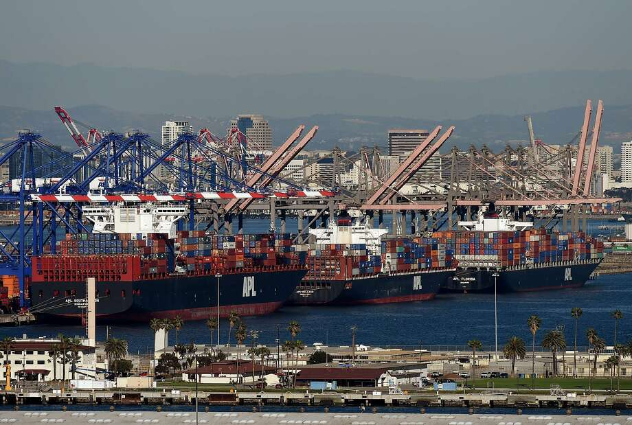 (FILES) This February 13, 2015 file photo shows ships as they wait to be unloaded at the Port of Los Angeles in Long Beach, California.  The US trade deficit fell to $41.8 billion in January as imports declined more than exports, the Commerce Department said March 6, 2015. The trade gap narrowed from a downwardly revised December reading of $45.6 billion, previously estimated at $46.6 billion. The January number was slightly less than analysts expected. AFP PHOTO/Mark RALSTONMARK RALSTON/AFP/Getty Images Photo: Mark Ralston, AFP / Getty Images