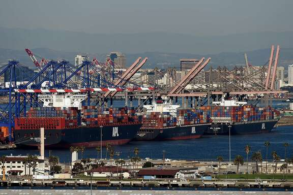 (FILES) This February 13, 2015 file photo shows ships as they wait to be unloaded at the Port of Los Angeles in Long Beach, California.  The US trade deficit fell to $41.8 billion in January as imports declined more than exports, the Commerce Department said March 6, 2015. The trade gap narrowed from a downwardly revised December reading of $45.6 billion, previously estimated at $46.6 billion. The January number was slightly less than analysts expected. AFP PHOTO/Mark RALSTONMARK RALSTON/AFP/Getty Images