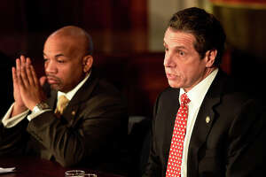 Gov. Andrew Cuomo, right and Assembly Democratic Majority Speaker Carl Heastie announced details of a two-way ethics reform agreement they reached Tuesday night during a press conference Wednesday morning March 18, 2015 in the Red Room of the Capitol in Albany, N.Y.   Highlights include a swipe card requirement for lawmakers claiming per diems and detailed outside income disclosure.    (Skip Dickstein/Times Union)