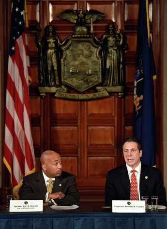 Gov. Andrew Cuomo, right and Assembly Democratic Majority Speaker Carl Heastie announced details of a two-way ethics reform agreement they reached Tuesday night during a press conference Wednesday morning March 18, 2015 in the Red Room of the Capitol in Albany, N.Y.   Highlights include a swipe card requirement for lawmakers claiming per diems and detailed outside income disclosure.    (Skip Dickstein/Times Union) Photo: SKIP DICKSTEIN, ALBANY TIMES UNION / 10031089A