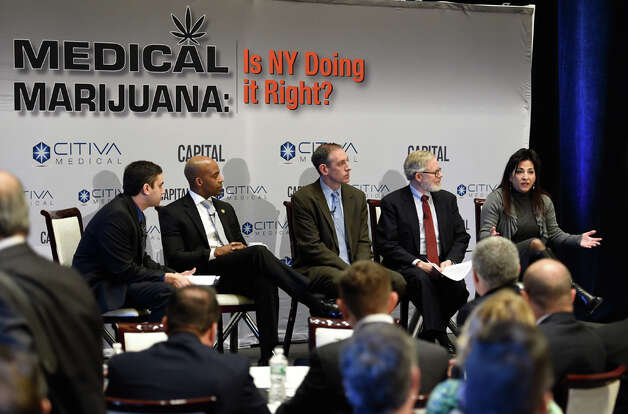 A panel of State and private sector speakers discuss the implementation of New York's medical marijuana bill at a Capital New York event Wednesday morning March 18, 2015 in Albany, N.Y.  The participants from left to right; Dan Goldberg, Capital NY; Alphonso David, Counsel to the Governor;  Steve Fox, of counsel, Vicente Sederberg, LLC;  Assemblyman Richard Gottfried and State Senator Diane Savino.    (Skip Dickstein/Times Union) Photo: SKIP DICKSTEIN, ALBANY TIMES UNION / 00030918A