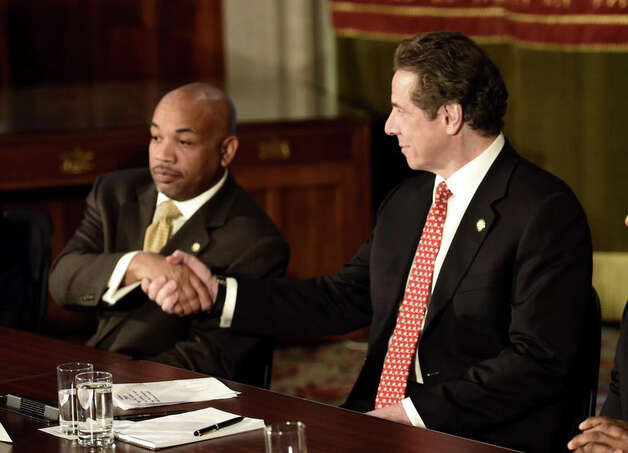 Speaker Heastie, left, and Gov. Andrew Cuomo shake hands on an ethics reform initiative during a press conference at the Capitol Wednesday, March 18, 2015, in Albany, N.Y. (Skip Dickstein/Times Union)