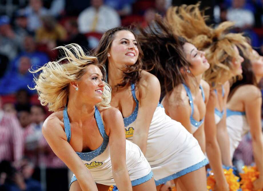 LOUISVILLE, KY - MARCH 19:  Cheerleaders from the UCLA Bruins performs during the second round of the 2015 NCAA Men's Basketball Tournamenat at the KFC YUM! Center on March 19, 2015 in Louisville, Kentucky. Photo: Joe Robbins, Getty Images / 2015 Getty Images