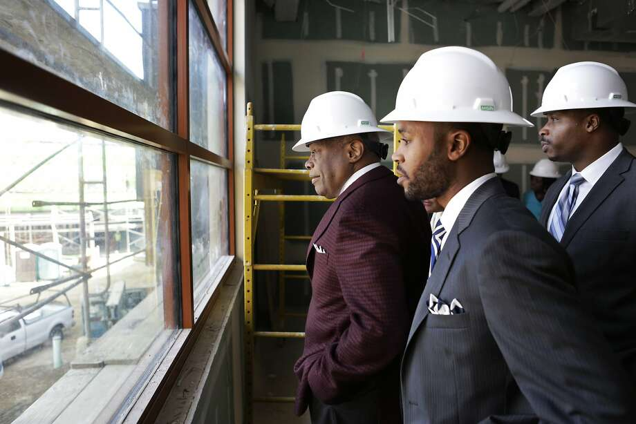Former Mayor Willie Brown (left), and incoming principal Demetrius Hobson, (center) tour the new Willie Brown Middle School in the Bayview Neighborhood of San Francisco on Thursday, March 19, 2015. Brown's visit came as district officials were announcing assignment numbers for the school this fall. Photo: Terray Sylvester, The Chronicle