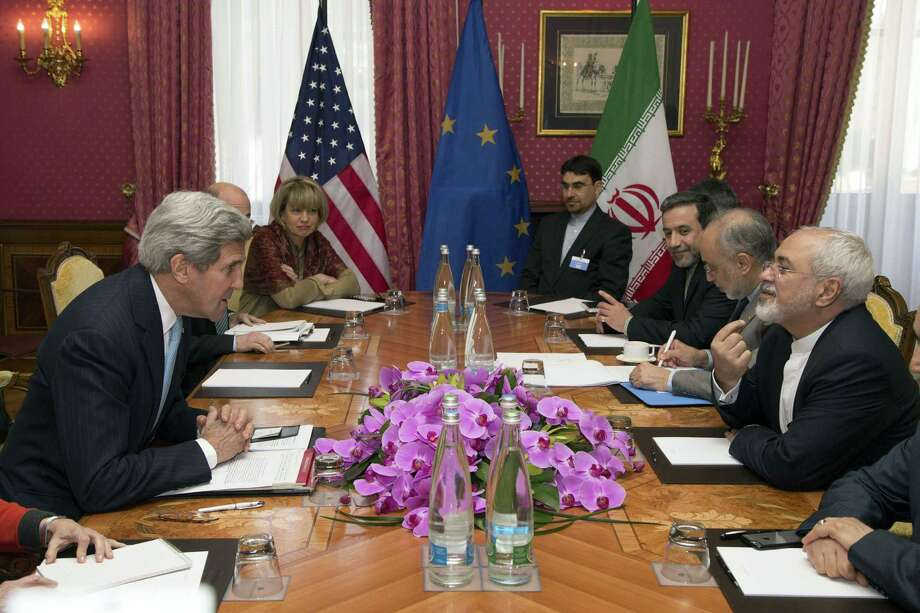 Secretary of State John Kerry meets with Iran's Foreign Minister Mohammad Javad Zarif on Wednesday over Iran's nuclear program. With the U.S. military threat ringing hollow, the West has limited leverage in the talks. Photo: BRIAN SNYDER /AFP / Getty Images / AFP