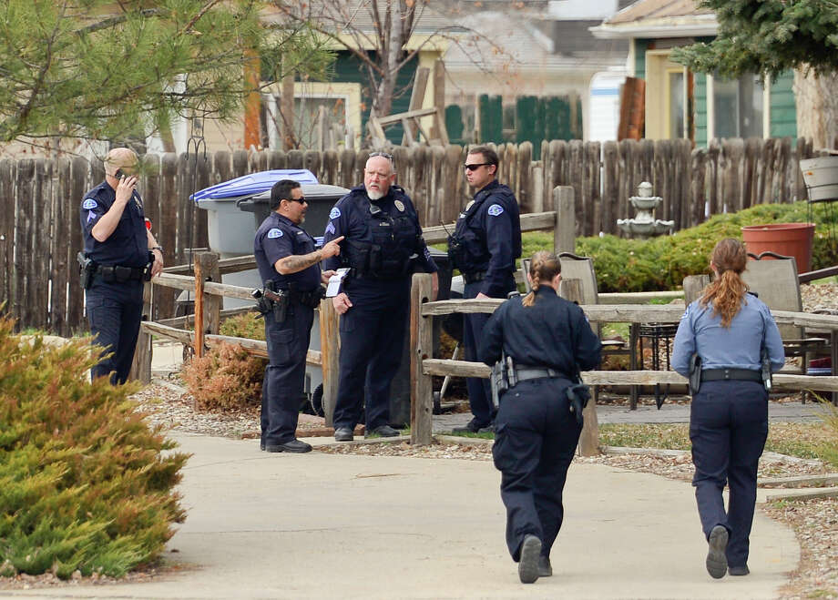 Police arrive at the scene of a stabbing on Wednesday in Longmont, Colo. Dynel Lyne, 34,  is accused of stabbing a pregnant woman in the stomach and removing her baby, while the expectant mother visited her home to buy baby clothes.  Photo: Matthew Jonas, MBO / Longmont Times-Call