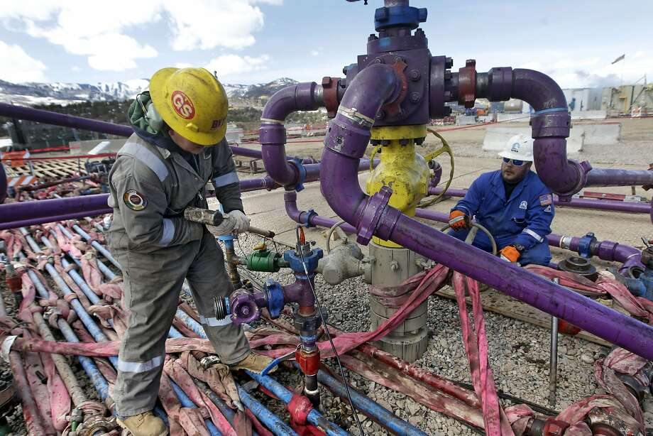 "In this March 29, 2013 file photo, workers tend to a well head during a hydraulic fracturing operation at an Encana Oil & Gas (USA) Inc. gas well outside Rifle, in western Colorado. The Obama administration is proposing a rule that would require companies that drill for oil and natural gas on federal lands to publicly disclose chemicals used in hydraulic fracturing operations. The new ""fracking"" rule replaces a draft proposed last year that was withdrawn amid industry complaints that federal regulation could hinder an ongoing boom in natural gas production. Photo: Brennan Linsley, Associated Press"
