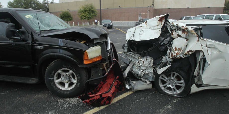 This file photo shows wrecked vehicles were shown to jurors last March during a DWI trial. A Bexar County jury recently gave a repeat drunken driving offender a 75-year sentence in a case involving a fatality. Photo: John Davenport /San Antonio Express-News / ©San Antonio Express-News