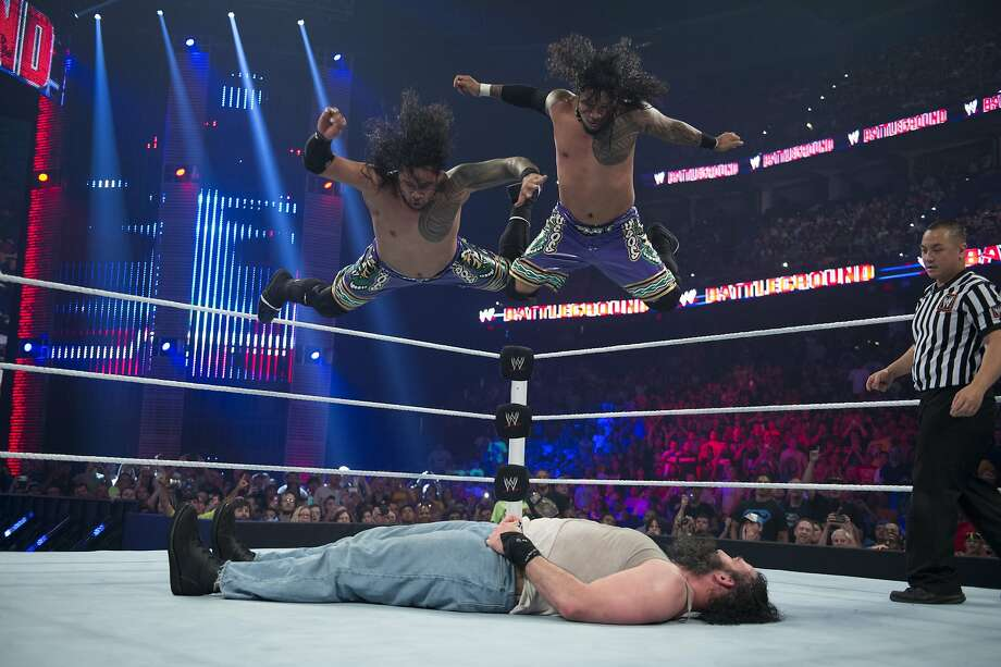 WWE Superstars Jimmy and Jey Uso deliver a top rope splash on Luke Harper. The Usos will be a part of WrestleMania 31 at Levi's Stadium.