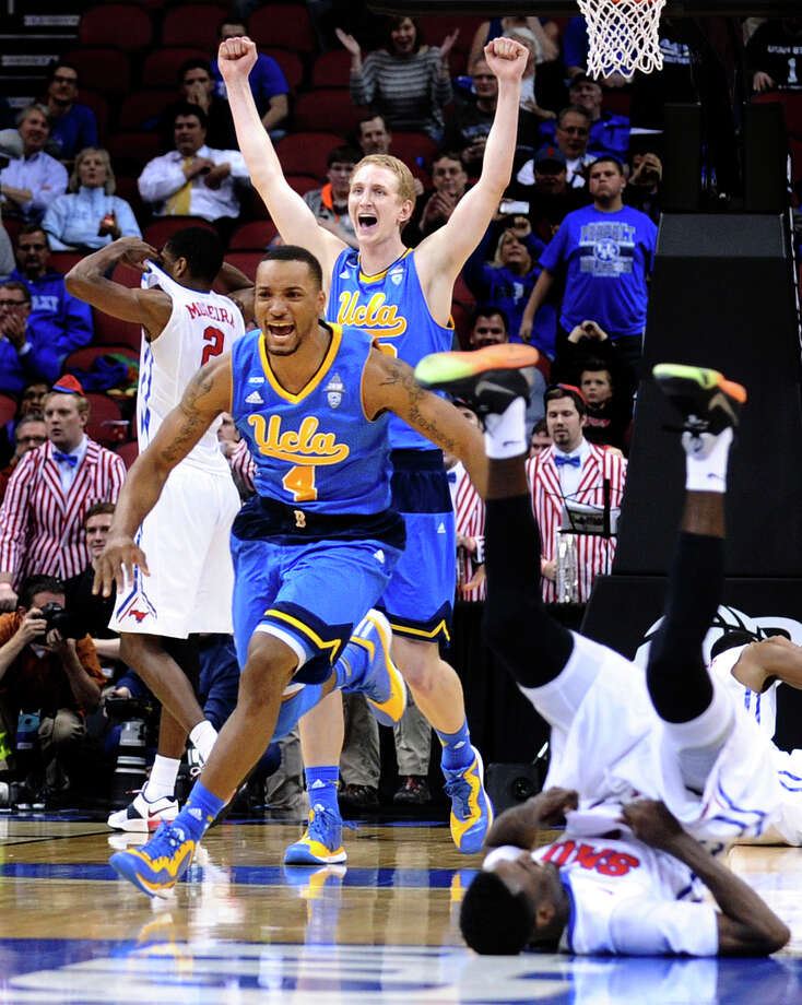 UCLA's Norman Powell (4) and Thomas Welsh celebrate their 60-59 win amid some distraught Southern Methodist players. Photo: Wally Skalij / McClatchy-Tribune News Service / Los Angeles Times