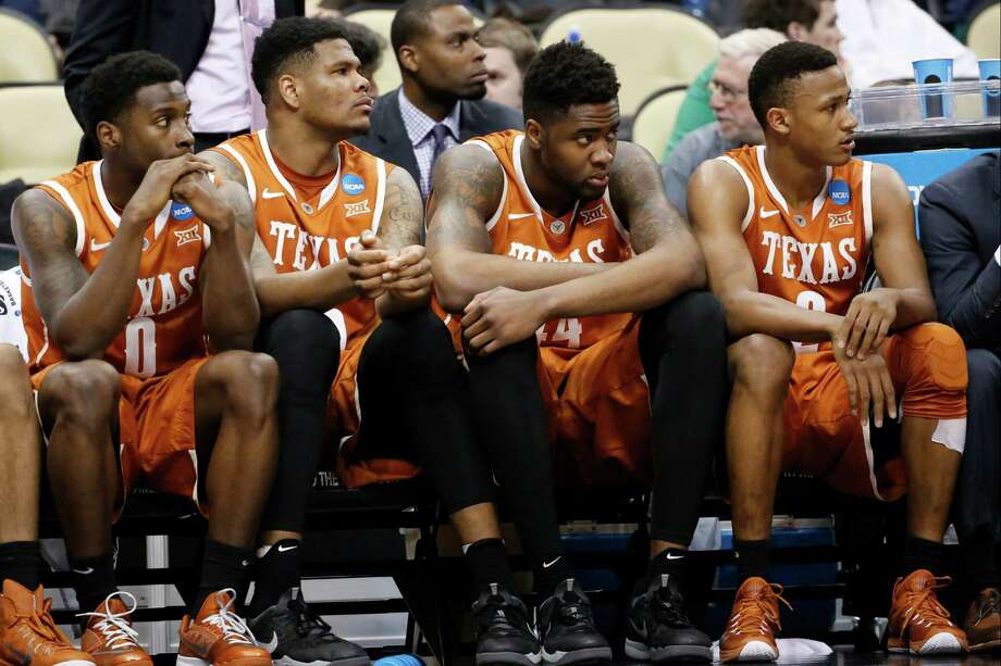 Texas players look on with their team losing to Butler with time running out in the second half on March 19, 2015, in Pittsburgh. Butler won 56-48 to advance to the third round. Photo: Gene J. Puskar /Associated Press / AP