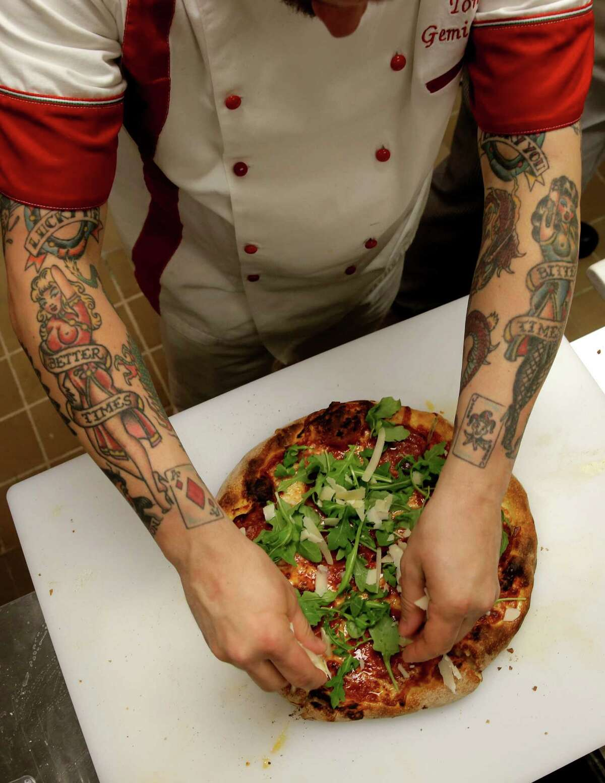 Tony Gemignani demonstrates to his kitchen staff the proper preparation of one of his award-winning pizza at his newest Pizza Rock restaurant located n Henderson, Nv., on Wed. March 11, 2015.