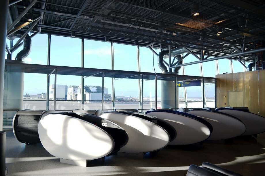 The Helsinki airport is the first in Europe to offer weary travelers sleeping pods--ergonomic seats that turn into a covered bed, with room for luggage beneath them. Photo: Finavia