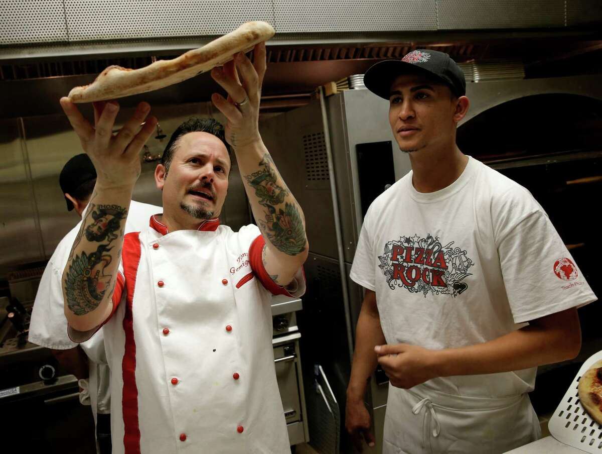 Right: Tony Gemignani (left) demonstrates the perfect crust bottom to Younes Zidal of his kitchen staff at the Pizza Rock restaurant near Las Vegas.