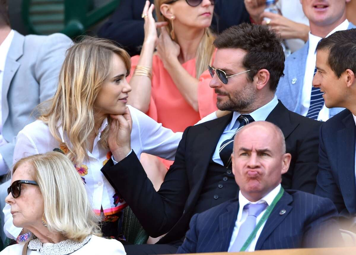 Suki Waterhouse and Bradley Cooper attend the semi-final match between Noval Djokovic and Grigor Dimitrov on centre court at The Wimbledon Championships at Wimbledon on July 4, 2014 in London, England.