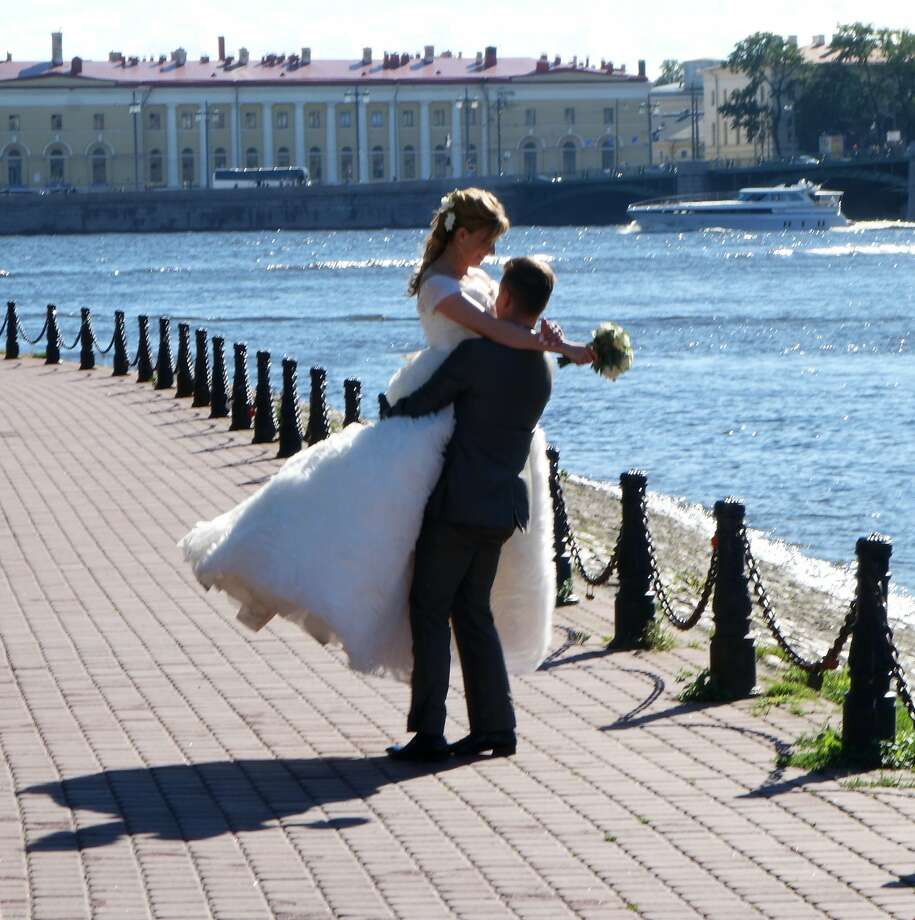 Many newlyweds in St. Petersburg use city landmarks as a backdrop for their wedding photos.  01-29-2015_StPeteCouple_RS.jpg Photo: Rick Steves