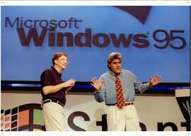 SEA02:MICROSOFT:REDMOND,WA,24AUG95- Microsoft Chairman Bill Gates (L) looks on  as The Tonight Show's Jay Leno co-hosts the official launch of Windows '95 at   the Microsoft campus in Redmond, Washington August 24. jv/Photo by Jeff Vinnick REUTERS