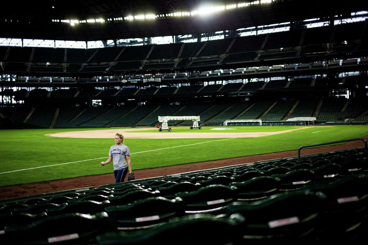 Young female athletes deftly scoop up foul balls while competing to be considered for 10 to 12 positions of Mariners Ball Girls for the upcoming 2015 season. Photographed Thursday, March 19, 2015, at Safeco Field in Seattle, Washington. Candidates were judged on their fielding skills and through an interview process. In addition to fielding foul balls during games, Mariners Ball Girls help with pregame activities, interact with fans and act as ambassadors for the Mariners in a variety of settings.