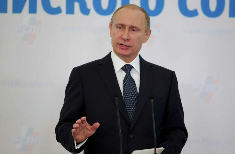 Russian President Vladimir Putin gestures speaking at an business forum in Moscow, Russia, on Thursday, March 19, 2015. Putin has urged a gathering of Russia's billionaires and business leaders to return their capital to Russia and suggested that funds kept abroad could be frozen. (AP Photo/Pavel Golovkin) Photo: Pavel Golovkin, STF / AP