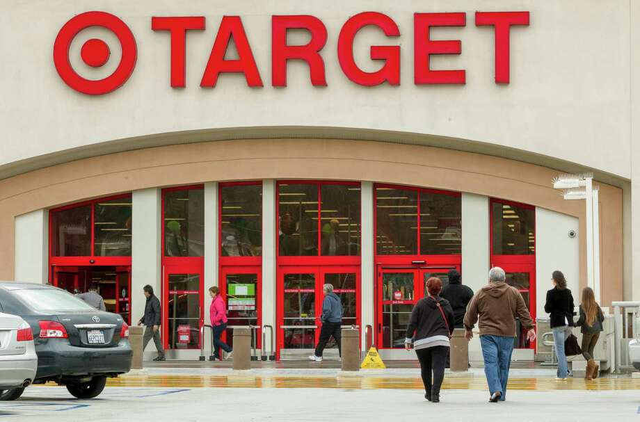 FILE - In this Dec. 19, 2013, file photo, shoppers arrive at a Target store in Los Angeles. Target has proposed to pay $10 million to settle a class-action lawsuit brought against it following a massive data breach in 2013. (AP Photo/Damian Dovarganes, File) Photo: Damian Dovarganes, STF / AP