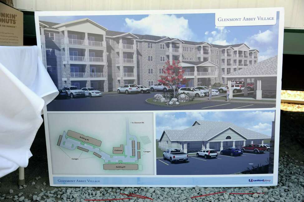 A poster with photos and a rendering is seen at a groundbreaking ceremony for Glenmont Abbey Village on Thursday, March 19, 2015 in Glenmont, N.Y. (Lori Van Buren / Times Union)