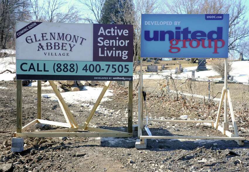 Signs are posted at a groundbreaking ceremony for Glenmont Abbey Village on Thursday, March 19, 2015 in Glenmont, N.Y. (Lori Van Buren / Times Union)