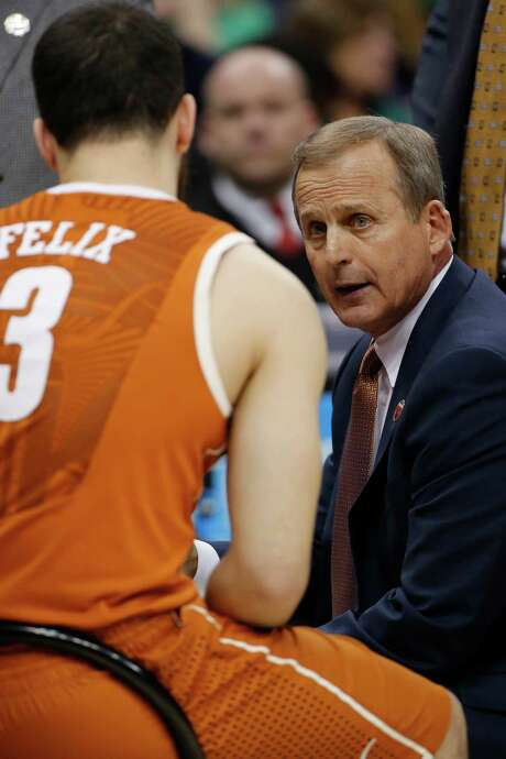 Texas coach Rick Barnes has the attention of guard Javan Felix during Thursday's loss to Butler. The next important discussion for Barnes? A meeting with athletic director Steve Patterson about Barnes' job status after 17 seasons. Photo: Gene J. Puskar, STF / AP