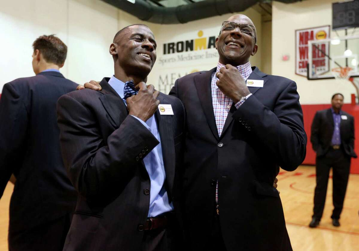 Once the source of his frustration, Vernon Maxwell, left, trades smiles with Clyde Drexler at the Rockets' 20th anniversary of their titles.
