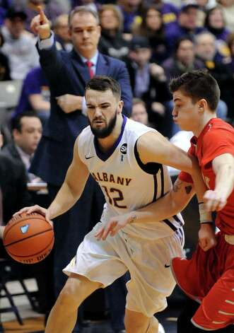 UAlbany's Peter Hooley, right, controls the ball during their America East Championship game against Stony Brook on Saturday, March 13, 2015, at UAlbany in Albany, N.Y. (Cindy Schultz / Times Union) Photo: Cindy Schultz / 00030954A