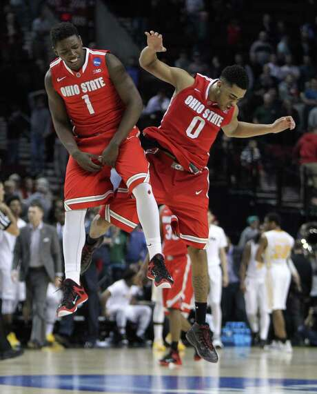 Guard D'Angelo Russell, right, is jumping for joy with teammate Jae'Sean Tate after his 28-point performance propelled Ohio State past VCU in overtime Thursday. Photo: Craig Mitchelldyer, FRE / FR17075AP