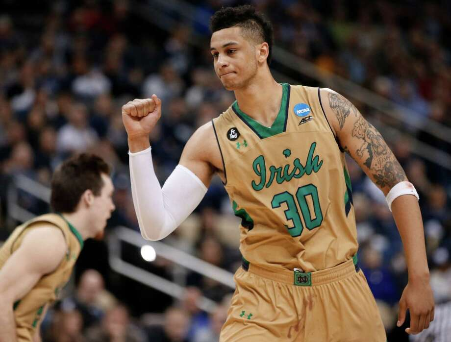 Zach Auguste, who led Notre Dame with 25 points, savors the moment as the clock winds down on the Irish's win over Northeastern. Photo: Gene J. Puskar, STF / AP