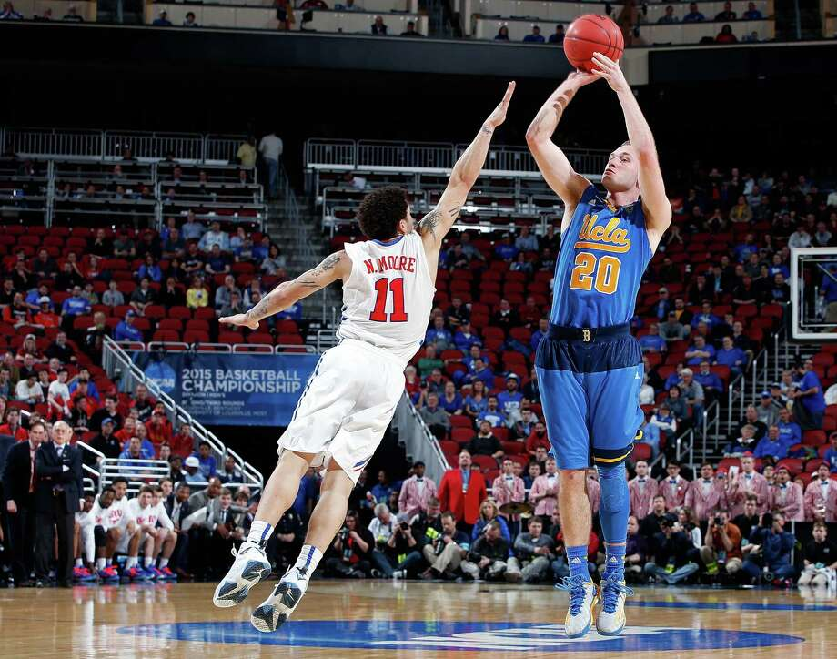 Bryce Alford lines up a last-minute 3-pointer that wasn't on target, unlike most of his shots Thursday, but the UCLA guard was bailed out by a goaltending call against SMU's Yanick Moreira. Photo: Joe Robbins, Stringer / 2015 Getty Images