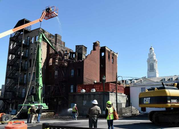 Demolition of 104 Jay Street commences Thursday afternoon, March 19, 2015, in Schenectady, N.Y.  (Skip Dickstein/Times Union) Photo: SKIP DICKSTEIN