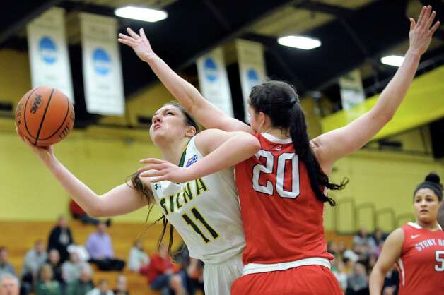 Siena's Margot Hetzke, left, goes to the hoop as Stony Brook's Brittany Snow defends during the Women's Basketball Invitational on Thursday, March 19, 2015, at Siena College in Loudonville, N.Y. Siena wins 53-46. (Cindy Schultz / Times Union) Photo: Cindy Schultz / 10031106A
