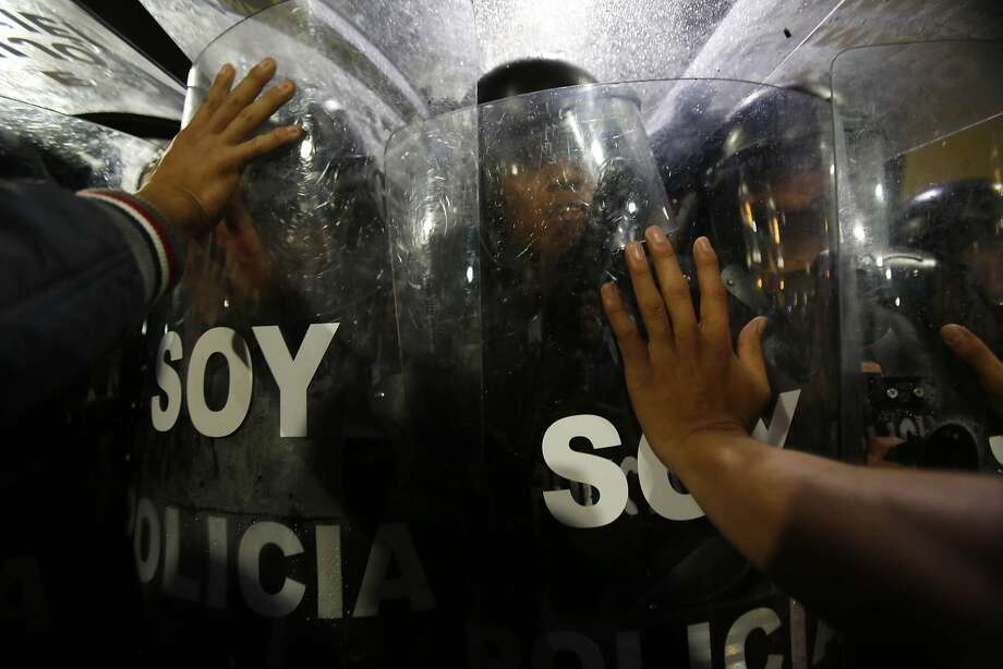 Police block protesters from reaching Independence Plaza, where they wanted to protest the government of President Rafael Correa outside the presidential palace, in downtown Quito, Ecuador, Thursday, March 19, 2015. Demonstrators are protesting government proposed laws, including a labor law, an initiative on land ownership and a series of constitutional reforms that would allow indefinite reelection for all elected officials. Photo: Dolores Ochoa, Associated Press
