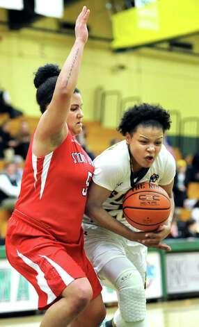Siena's Kollus Scarbrough, right, bobbles the ball as Stony Brook's Kori Bayne-Walker defends during the Women's Basketball Invitational on Thursday, March 19, 2015, at Siena College in Loudonville, N.Y. Siena wins 53-46. (Cindy Schultz / Times Union) Photo: Cindy Schultz / 10031106A