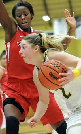 Siena's Ida Krogh, right, drives for the hoop as Stony Brook's Jessica Ogunnorin defends during the Women's Basketball Invitational on Thursday, March 19, 2015, at Siena College in Loudonville, N.Y. Siena wins 53-46. (Cindy Schultz / Times Union) Photo: Cindy Schultz / 10031106A