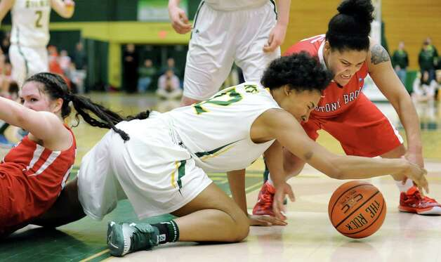 Siena's Symone Kelly, center, and Stony Brook's Kori Bayne-Walker, right, scramble for a loose ball during the Women's Basketball Invitational on Thursday, March 19, 2015, at Siena College in Loudonville, N.Y. (Cindy Schultz / Times Union) Photo: Cindy Schultz / 10031106A