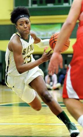 Siena's Tehresa Coles drives for the hoop during the Women's Basketball Invitational against Stony Brook on Thursday, March 19, 2015, at Siena College in Loudonville, N.Y. (Cindy Schultz / Times Union) Photo: Cindy Schultz / 10031106A